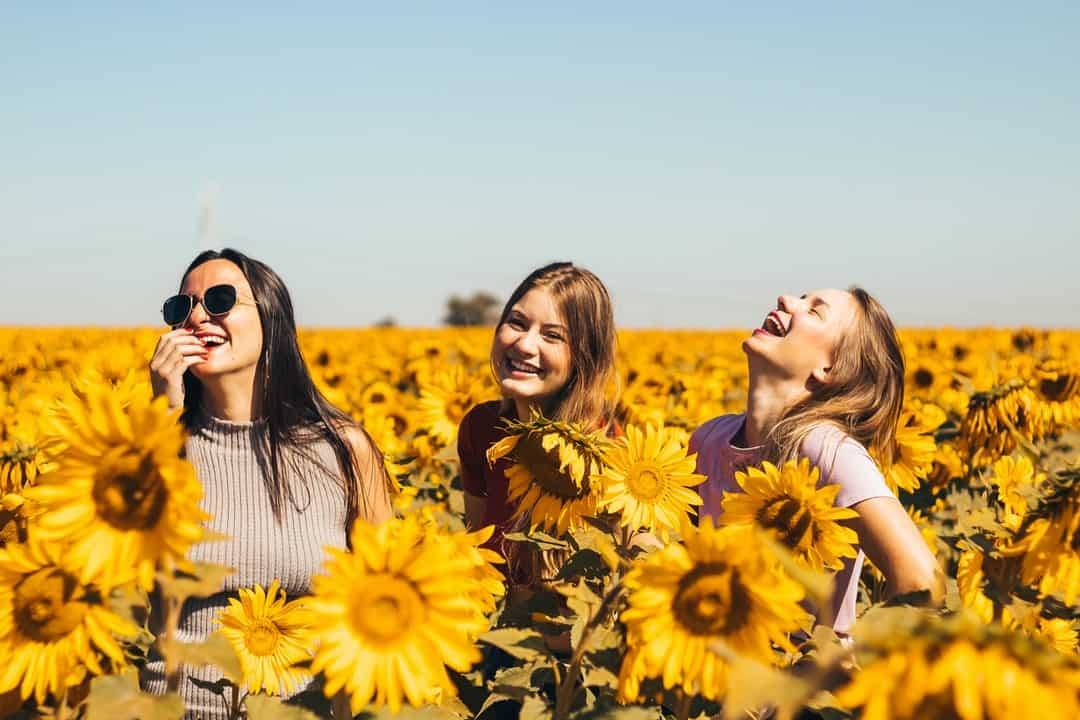 A group of people standing on a flower